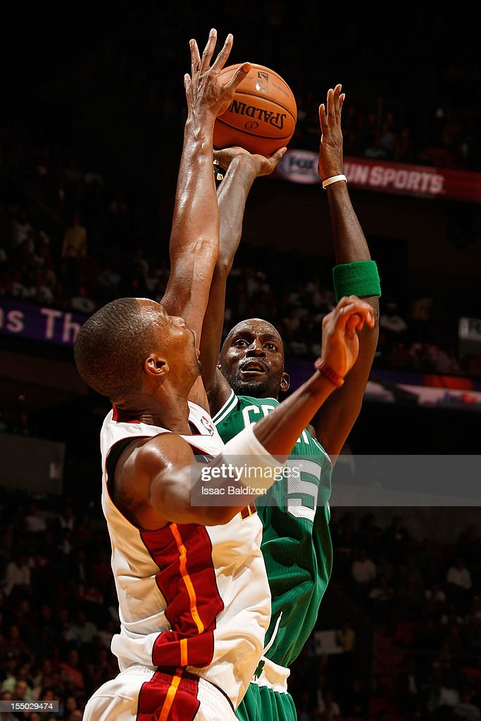 Kevin Garnett #5 of the Boston Celtics shoots against Chris Bosh #1 of the Miami Heat during the NBA game on October 30, 2012 at American Airlines Arena in Miami, Florida.