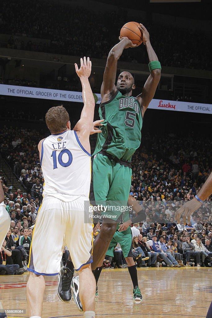 Kevin Garnett #5 of the Boston Celtics shoots against David Lee #10 of the Golden State Warriors on December 29, 2012 at Oracle Arena in Oakland, California.