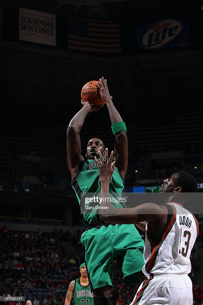 Kevin Garnett #5 of the Boston Celtics shoots against Ekpe Udoh #13 of the Milwaukee Bucks during the NBA game on December 1, 2012 at the BMO Harris Bradley Center in Milwaukee, Wisconsin.