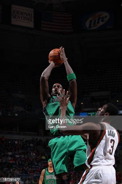 Kevin Garnett of the Boston Celtics shoots against Ekpe Udoh of the Milwaukee Bucks during the NBA game on December 1 2012 at the BMO Harris Bradley...