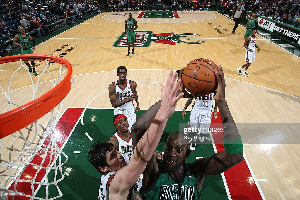Kevin Garnett #5 of the Boston Celtics shoots against Ersan Ilyasova #7 of the Milwaukee Bucks during the NBA game on December 1, 2012 at the BMO Harris Bradley Center in Milwaukee, Wisconsin.