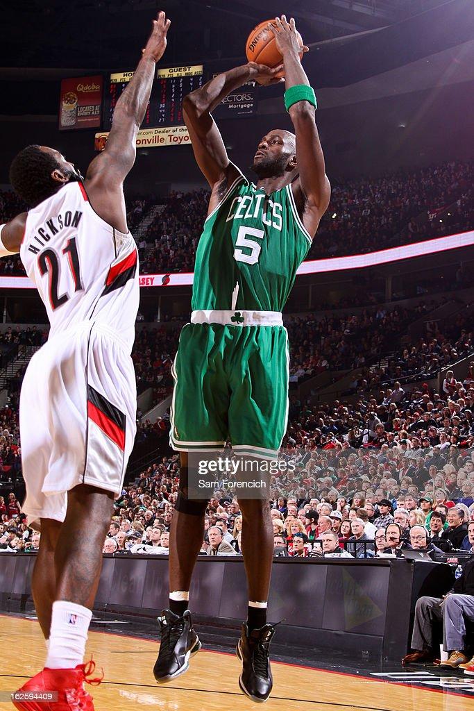 Kevin Garnett #5 of the Boston Celtics shoots against J.J. Hickson #21 of the Portland Trail Blazers on February 24, 2013 at the Rose Garden Arena in Portland, Oregon.