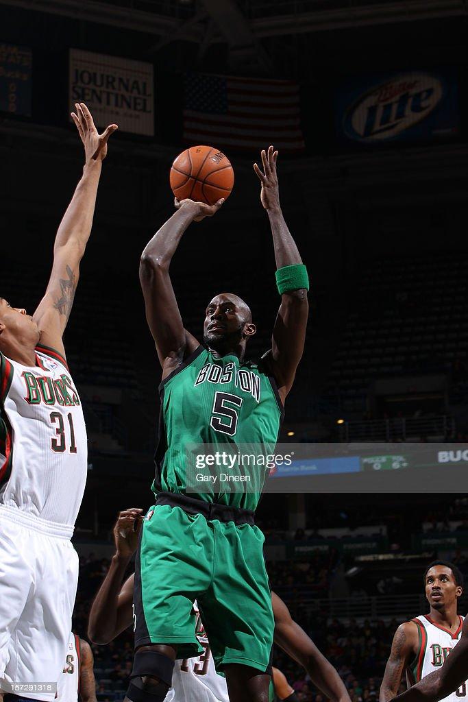 Kevin Garnett #5 of the Boston Celtics shoots against John Henson #31 of the Milwaukee Bucks during the NBA game on December 1, 2012 at the BMO Harris Bradley Center in Milwaukee, Wisconsin.