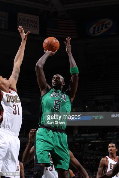 Kevin Garnett of the Boston Celtics shoots against John Henson of the Milwaukee Bucks during the NBA game on December 1 2012 at the BMO Harris...