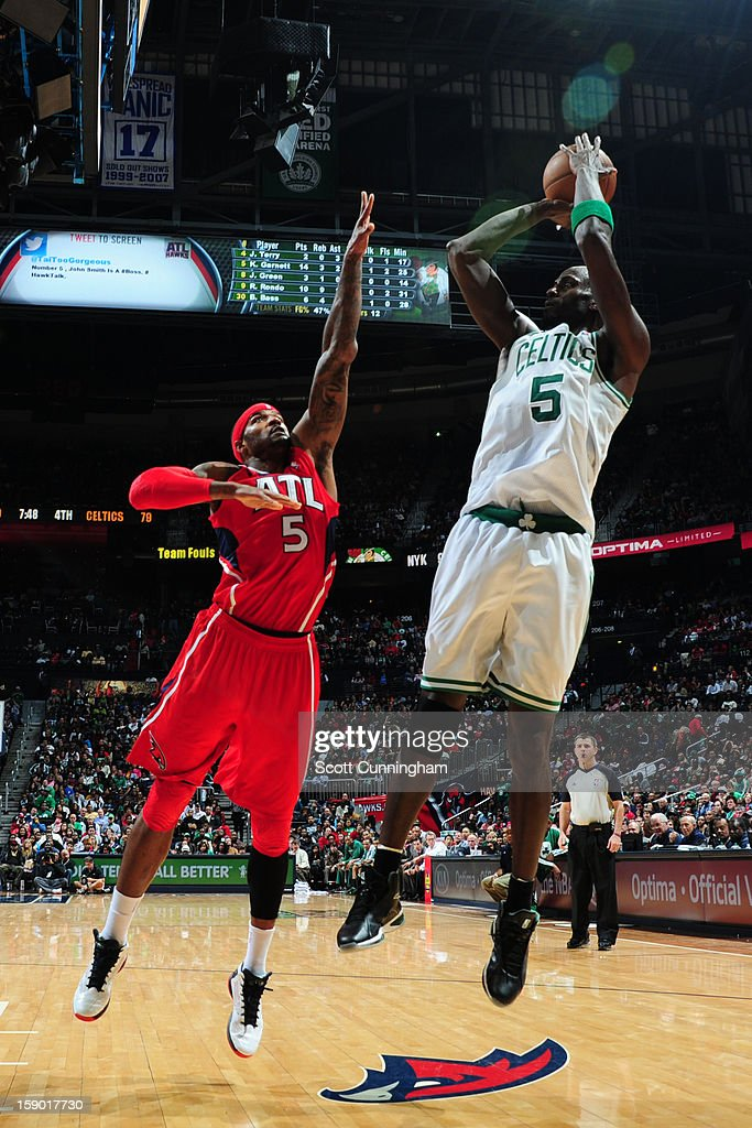 Kevin Garnett #5 of the Boston Celtics shoots against Josh Smith #5 of the Atlanta Hawks on January 5, 2013 at Philips Arena in Atlanta, Georgia.