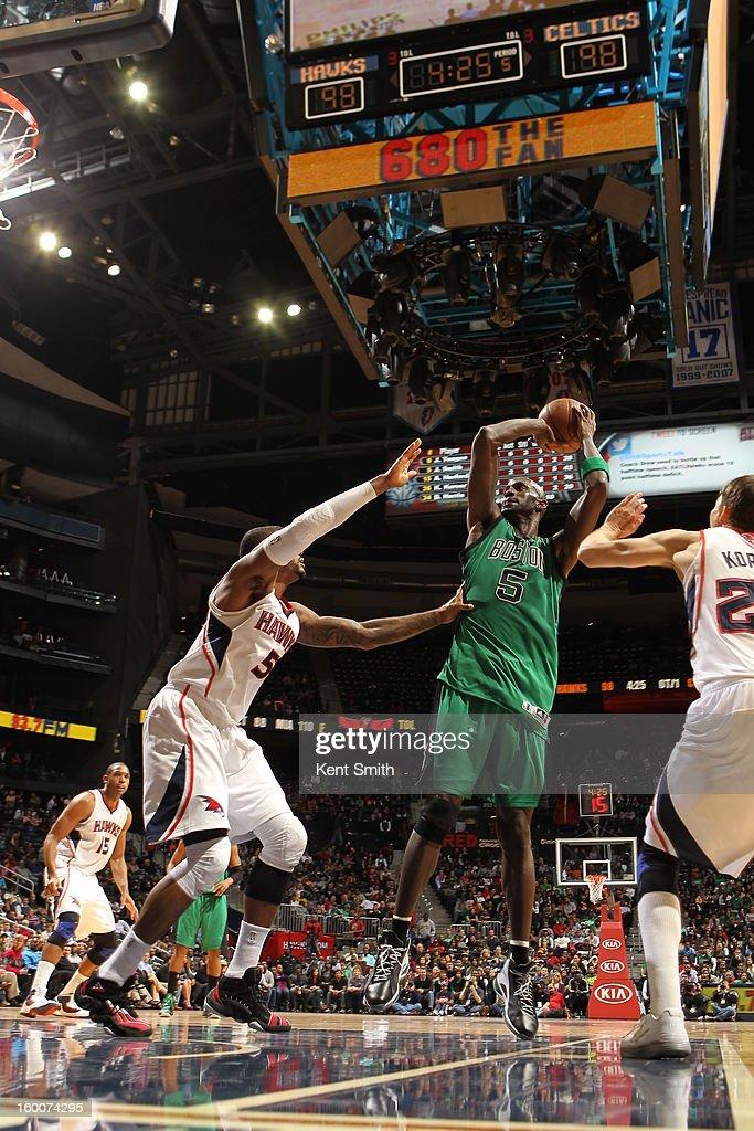 Kevin Garnett #5 of the Boston Celtics shoots against Josh Smith #5 of the Atlanta Hawks at the Philips Arena on January 25, 2013 in Atlanta, Georgia.