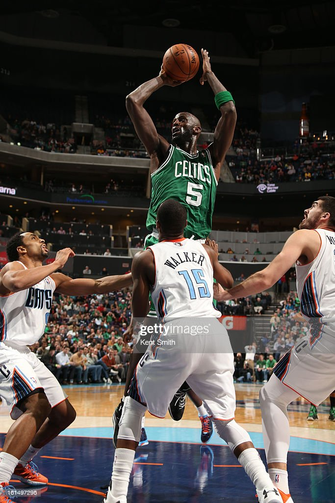 Kevin Garnett #5 of the Boston Celtics shoots against Kemba Walker #15 of the Charlotte Bobcats at the Time Warner Cable Arena on February 11, 2013 in Charlotte, North Carolina.