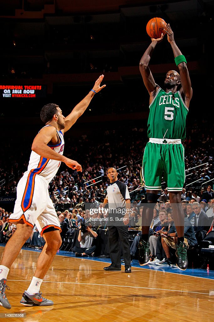 <a gi-track='captionPersonalityLinkClicked' href=/galleries/search?phrase=Kevin+Garnett&family=editorial&specificpeople=201473 ng-click='$event.stopPropagation()'>Kevin Garnett</a> #5 of the Boston Celtics shoots against <a gi-track='captionPersonalityLinkClicked' href=/galleries/search?phrase=Landry+Fields&family=editorial&specificpeople=4184645 ng-click='$event.stopPropagation()'>Landry Fields</a> #2 of the New York Knicks on April 17, 2012 at Madison Square Garden in New York City.