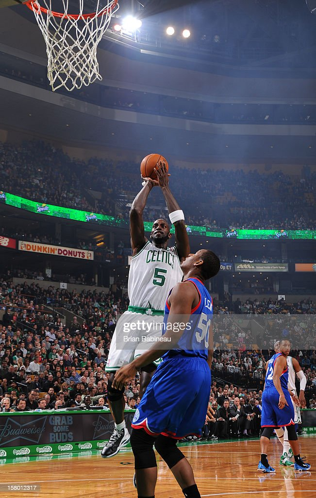 Kevin Garnett #5 of the Boston Celtics shoots against Lavoy Allen #50 of the Philadelphia 76ers on December 8, 2012 at the TD Garden in Boston, Massachusetts.