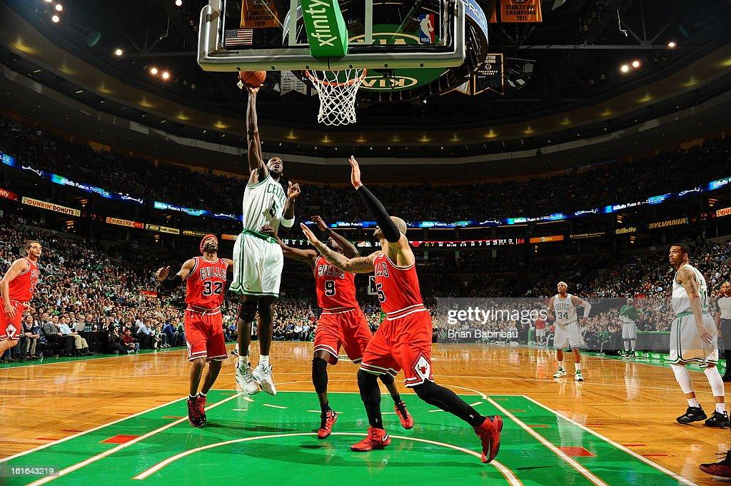 Kevin Garnett #5 of the Boston Celtics shoots against Luol Deng #9 and Carlos Boozer #5 of the Chicago Bulls on February 13, 2013 at the TD Garden in Boston, Massachusetts.