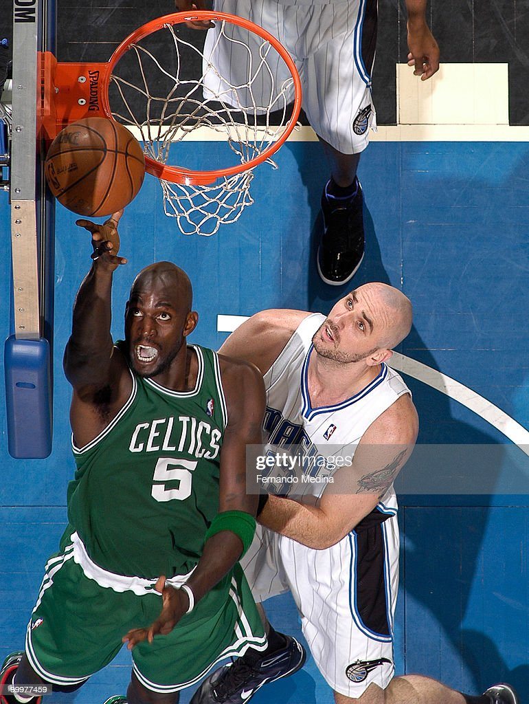 Kevin Garnett #5 of the Boston Celtics shoots against Marcin Gortat #13 of the Orlando Magic in Game Two of the Eastern Conference Finals during the 2010 NBA Playoffs on May 18, 2010 at Amway Arena in Orlando, Florida.