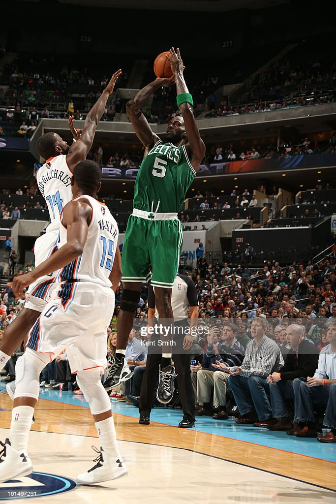 Kevin Garnett #5 of the Boston Celtics shoots against Michael Kidd-Gilchrist #14 of the Charlotte Bobcats at the Time Warner Cable Arena on February 11, 2013 in Charlotte, North Carolina.