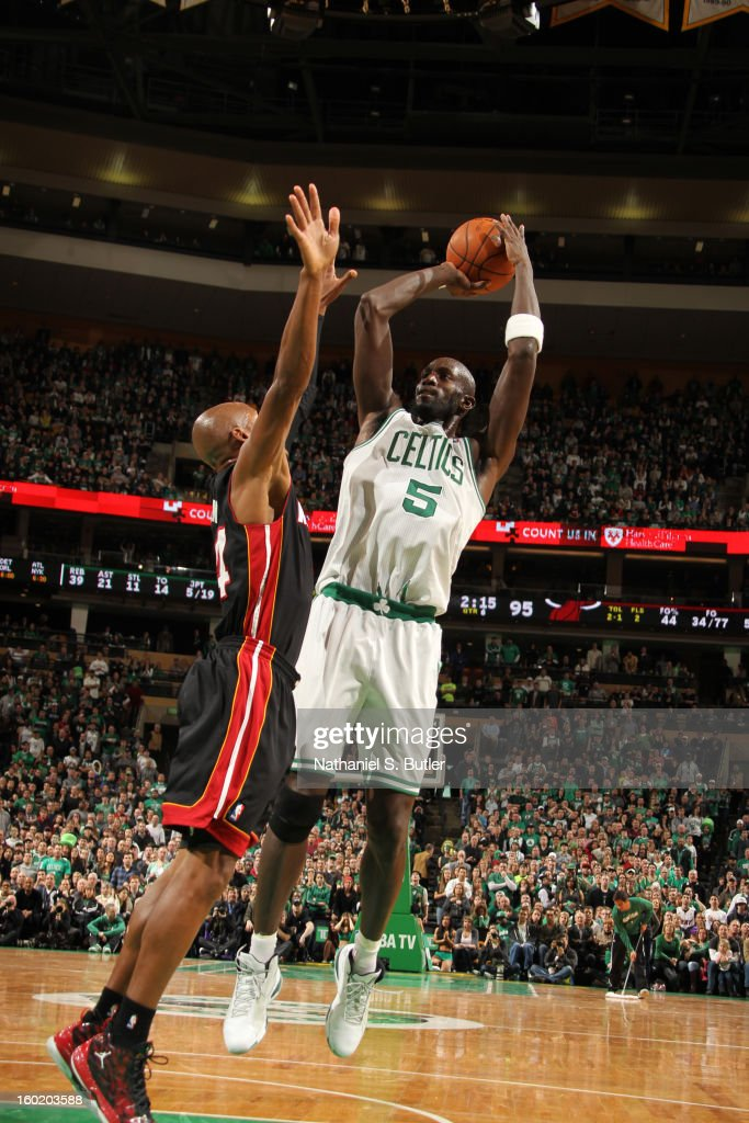 Kevin Garnett #5 of the Boston Celtics shoots against Ray Allen #34 of the Miami Heat on January 27, 2013 at TD Garden in Boston, Massachusetts.