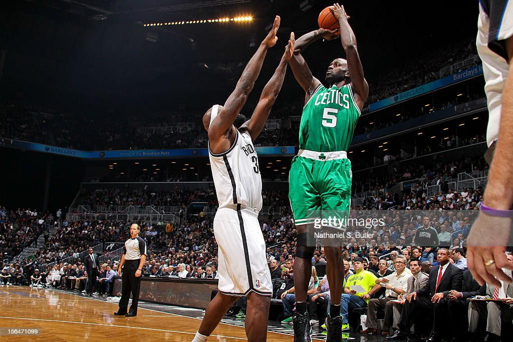 Kevin Garnett #5 of the Boston Celtics shoots against Reggie Evans #30 of the Brooklyn Nets on November 15, 2012 at the Barclays Center in the Brooklyn Borough of New York City.