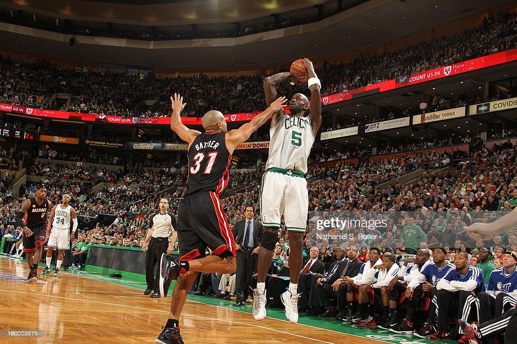 Kevin Garnett #5 of the Boston Celtics shoots against Shane Battier #31 of the Miami Heat on January 27, 2013 at TD Garden in Boston, Massachusetts.