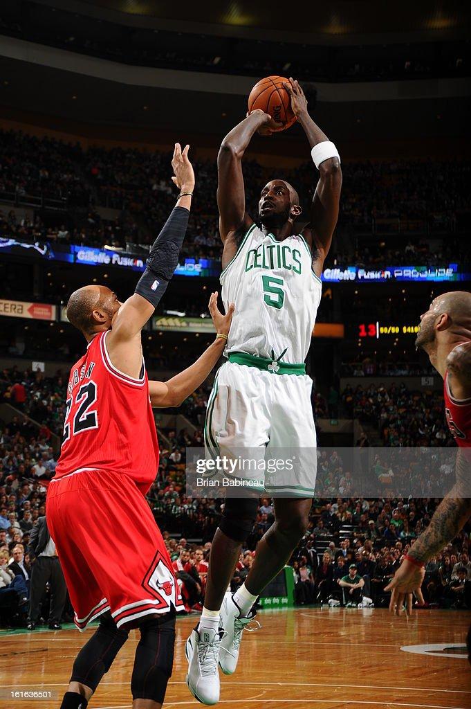 Kevin Garnett #5 of the Boston Celtics shoots against Taj Gibson #22 of the Chicago Bulls on February 13, 2013 at the TD Garden in Boston, Massachusetts.