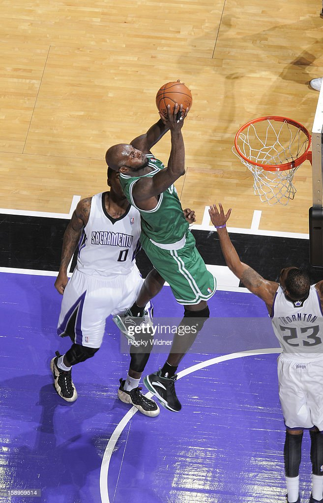 Kevin Garnett #5 of the Boston Celtics shoots against Thomas Robinson #0 and Marcus Thornton #23 of the Sacramento Kings on December 30, 2012 at Sleep Train Arena in Sacramento, California.