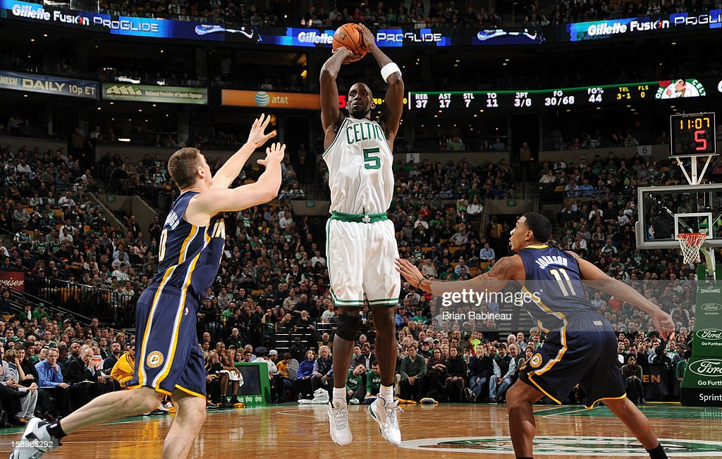Kevin Garnett #5 of the Boston Celtics shoots against Tyler Hansbrough #50 and Orlando Johnson #11 of the Indiana Pacers on January 4, 2013 at the TD Garden in Boston, Massachusetts.