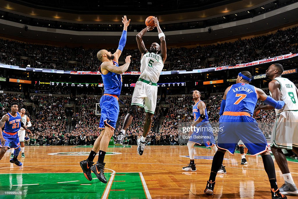 Kevin Garnett #5 of the Boston Celtics shoots against Tyson Chandler #6 of the New York Knicks on January 24, 2013 at the TD Garden in Boston, Massachusetts.