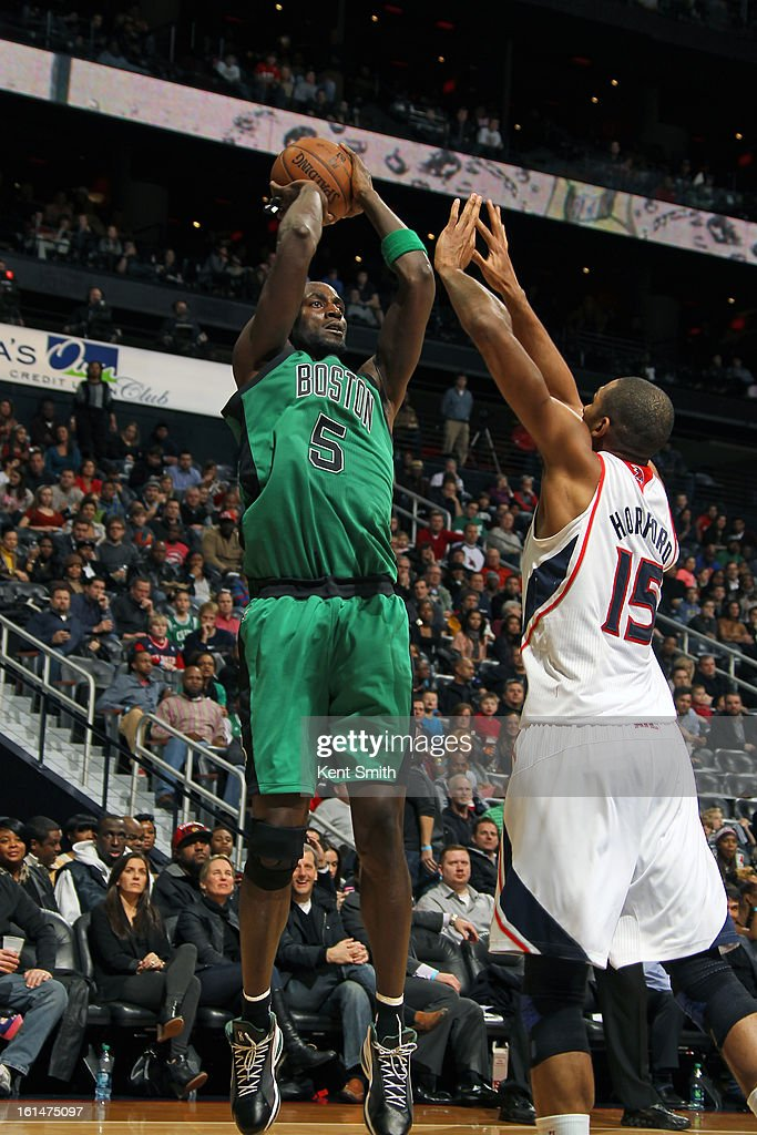 Kevin Garnett #15 of the Boston Celtics shoots over Al Horford #15 of the Atlanta Hawks at the Philips Arena on January 25, 2013 in Atlanta, Georgia.