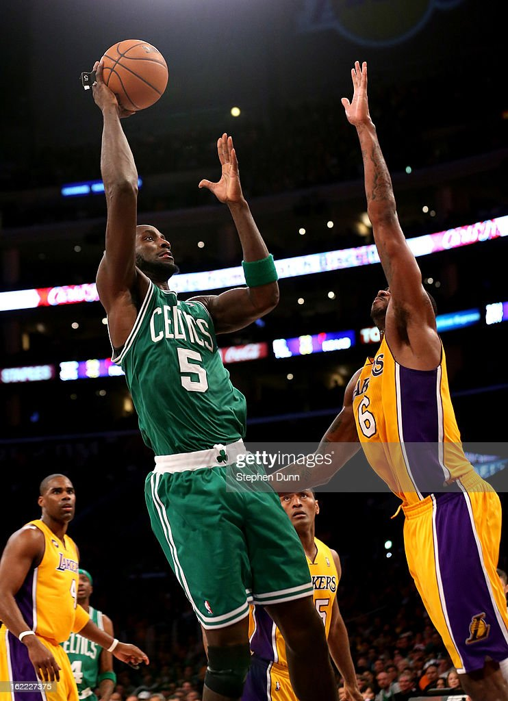 Kevin Garnett #5 of the Boston Celtics shoots over Earl Clark #6 of the Los Angeles Lakers at Staples Center on February 20, 2013 in Los Angeles, California.