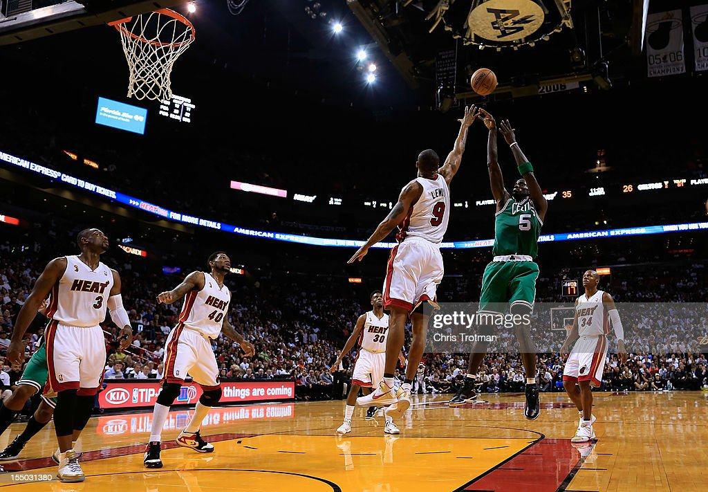 Kevin Garnett #5 of the Boston Celtics shoots over Rashard Lewis #9 of the Miami Heat at American Airlines Arena on October 30, 2012 in Miami, Florida.