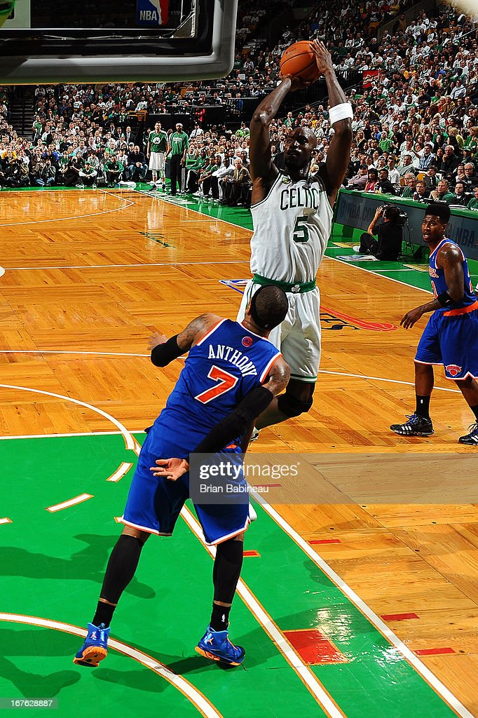 Kevin Garnett #5 of the Boston Celtics shoots the ball against Carmelo Anthony #7 of the New York Knicks during Game Three of the Eastern Conference Quarterfinals on April 26, 2013 at the TD Garden in Boston, Massachusetts.
