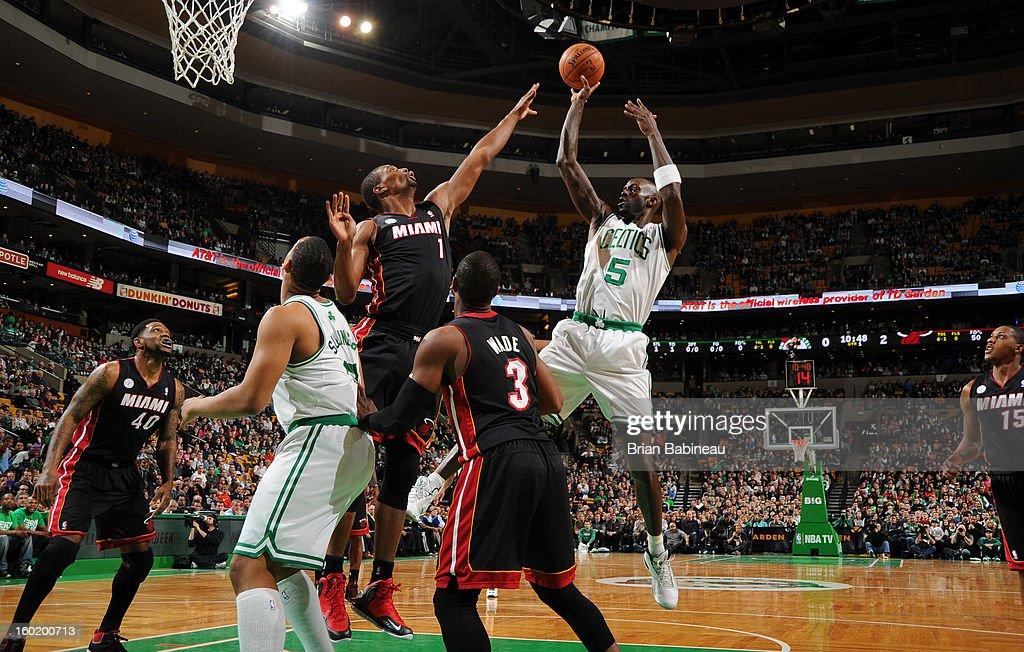 Kevin Garnett #5 of the Boston Celtics shoots the ball against Chris Bosh #1 of the Miami Heat on January 27, 2013 at the TD Garden in Boston, Massachusetts.