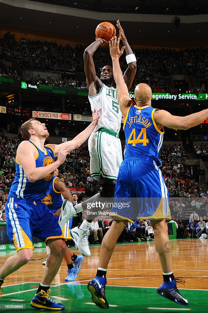 Kevin Garnett #5 of the Boston Celtics shoots the ball against David Lee #10 and Richard Jefferson #44 of the Golden State Warriors on March 1, 2013 at the TD Garden in Boston, Massachusetts.