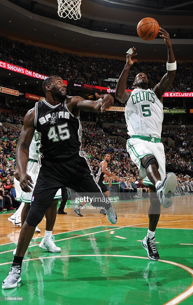 Kevin Garnett #5 of the Boston Celtics shoots the ball against DeJuan Blair #45 of the San Antonio Spurs on November 21, 2012 at the TD Garden in Boston, Massachusetts.