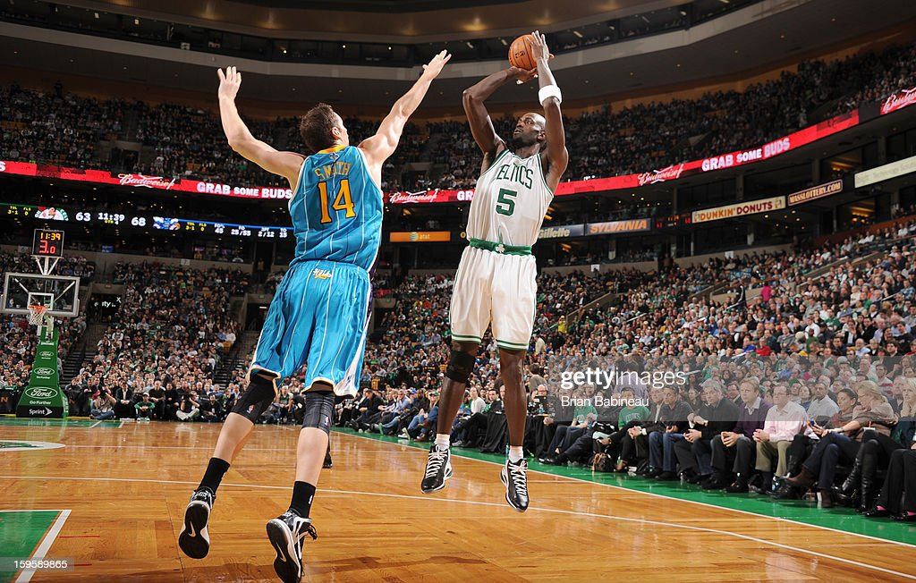 Kevin Garnett #5 of the Boston Celtics shoots the ball against Jason Smith #14 of the New Orleans Hornets on January 16, 2013 at the TD Garden in Boston, Massachusetts.