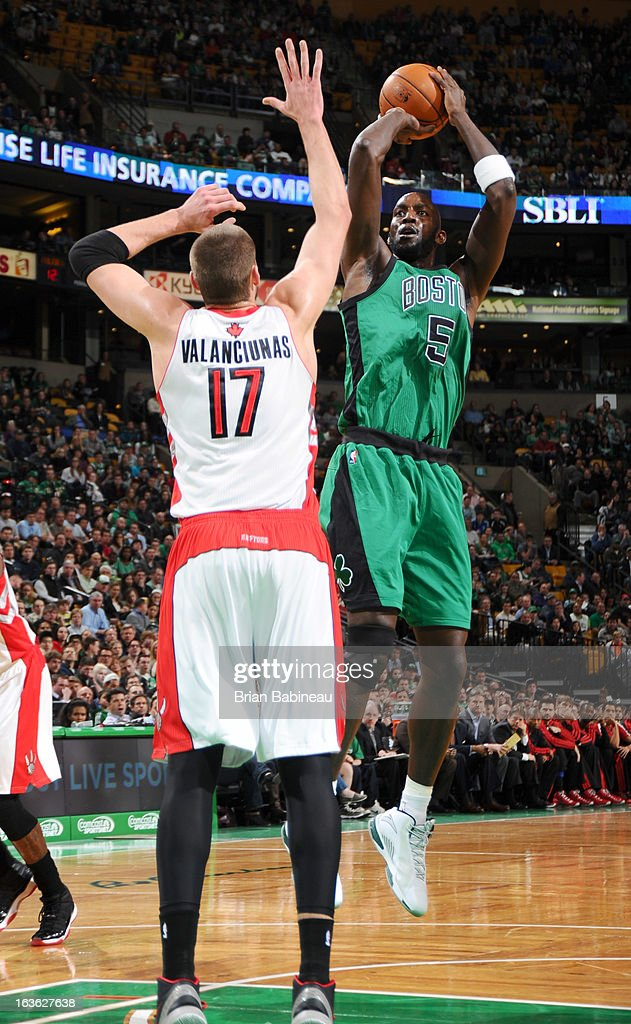 Kevin Garnett #5 of the Boston Celtics shoots the ball against Jonas Valanciunas #17 of the Toronto Raptors on March 13, 2013 at the TD Garden in Boston, Massachusetts.
