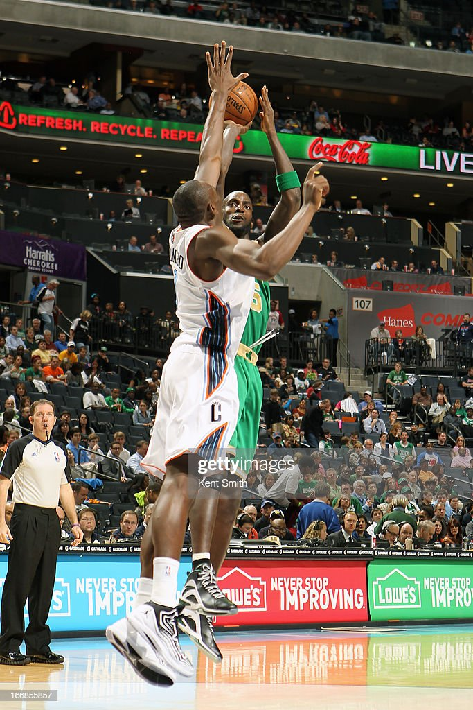 <a gi-track='captionPersonalityLinkClicked' href=/galleries/search?phrase=Kevin+Garnett&family=editorial&specificpeople=201473 ng-click='$event.stopPropagation()'>Kevin Garnett</a> #5 of the Boston Celtics shoots the ball against of the Charlotte Bobcats at the Time Warner Cable Arena on March 12, 2013 in Charlotte, North Carolina.