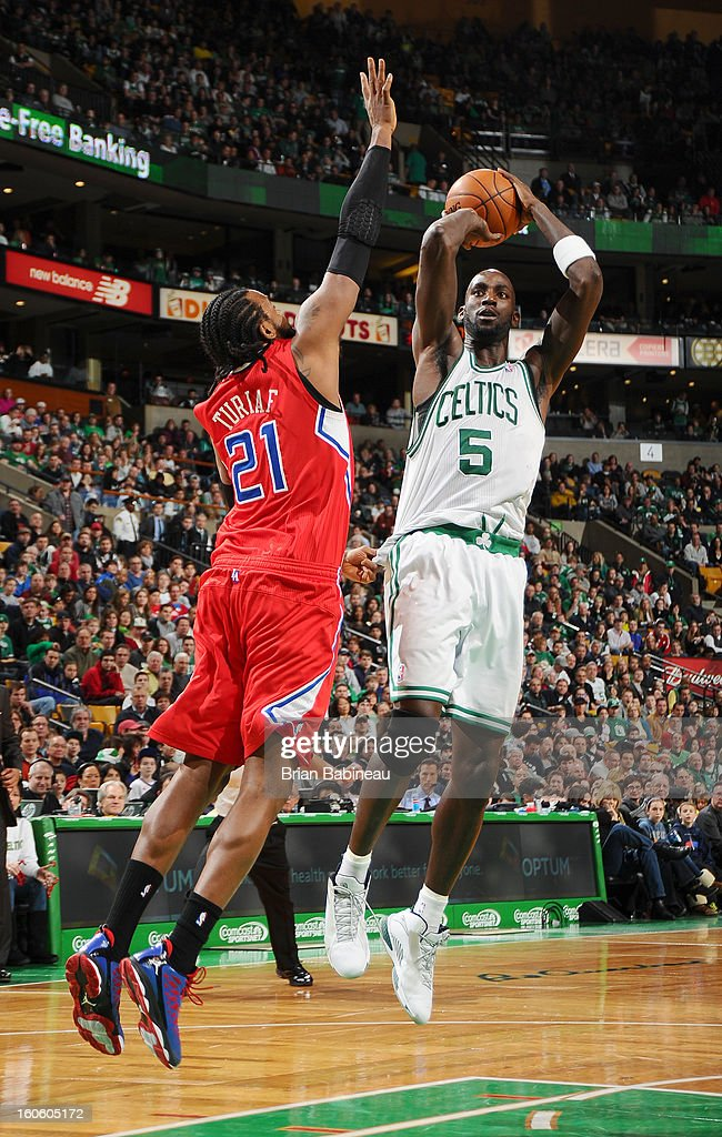 Kevin Garnett #5 of the Boston Celtics shoots the ball against Ronny Turiaf #21 of the Los Angeles Clippers on February 3, 2013 at the TD Garden in Boston, Massachusetts.