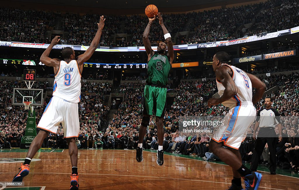 Kevin Garnett #5 of the Boston Celtics shoots the ball against Serge Ibaka #9 of the Oklahoma City Thunder on November 23, 2012 at the TD Garden in Boston, Massachusetts.