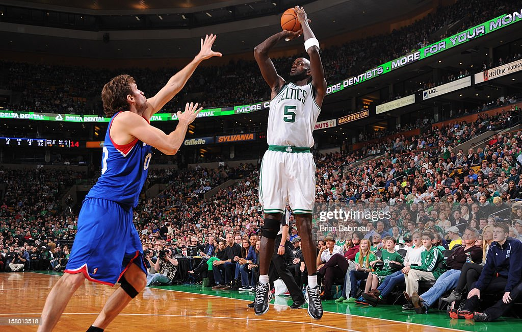 Kevin Garnett #5 of the Boston Celtics shoots the ball against Spencer Hawes #00 of the Philadelphia 76ers on December 8, 2012 at the TD Garden in Boston, Massachusetts.