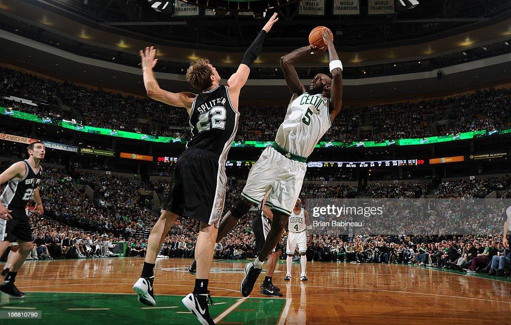Kevin Garnett #5 of the Boston Celtics shoots the ball against Tiago Splitter #22 of the San Antonio Spurs on November 21, 2012 at the TD Garden in Boston, Massachusetts.