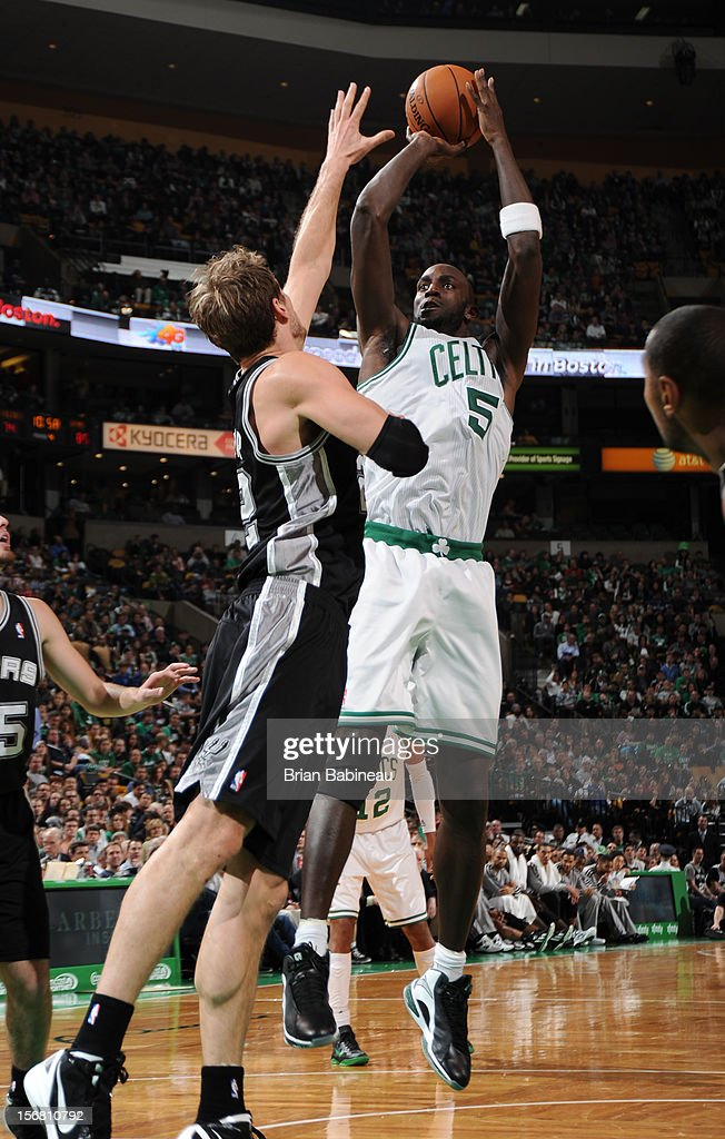 Kevin Garnett #5 of the Boston Celtics shoots the ball against Tiago Splitter #22 of the San Antonio Spurs on November 21, 2012 at the TD Garden in Boston, Massachusetts.