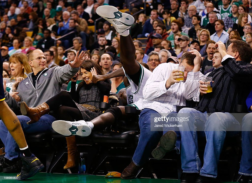Kevin Garnett #5 of the Boston Celtics spills into the fans sitting in the courtside seats attempting to grab a loose ball against the Indiana Pacers during the game on January 4, 2013 at TD Garden in Boston, Massachusetts.