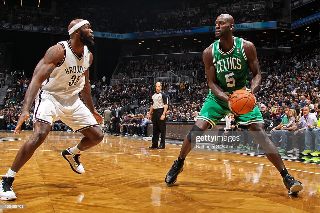 Kevin Garnett #5 of the Boston Celtics squares to shoot against Reggie Evans #30 of the Brooklyn Nets on November 15, 2012 at the Barclays Center in the Brooklyn borough of New York City.