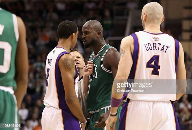 Kevin Garnett of the Boston Celtics stares down Channing Frye of the Phoenix Suns after Garnett was called for a technical foul during the NBA game...