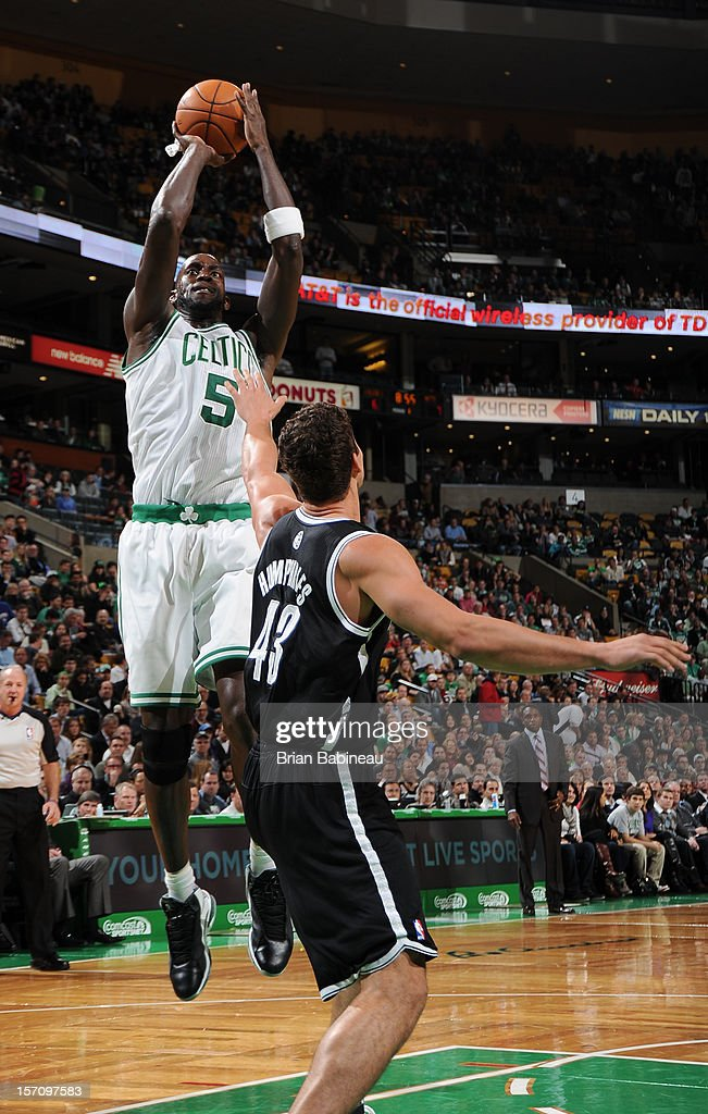 Kevin Garnett #5 of the Boston Celtics takes a jump shot against the Brooklyn Nets on November 28, 2012 at the TD Garden in Boston, Massachusetts.