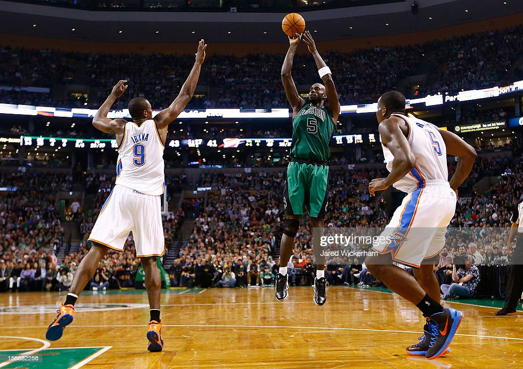 Kevin Garnett #5 of the Boston Celtics takes a shot in front of Serge Ibaka #9 of the Oklahoma City Thunder during the game on November 23, 2012 at TD Garden in Boston, Massachusetts.