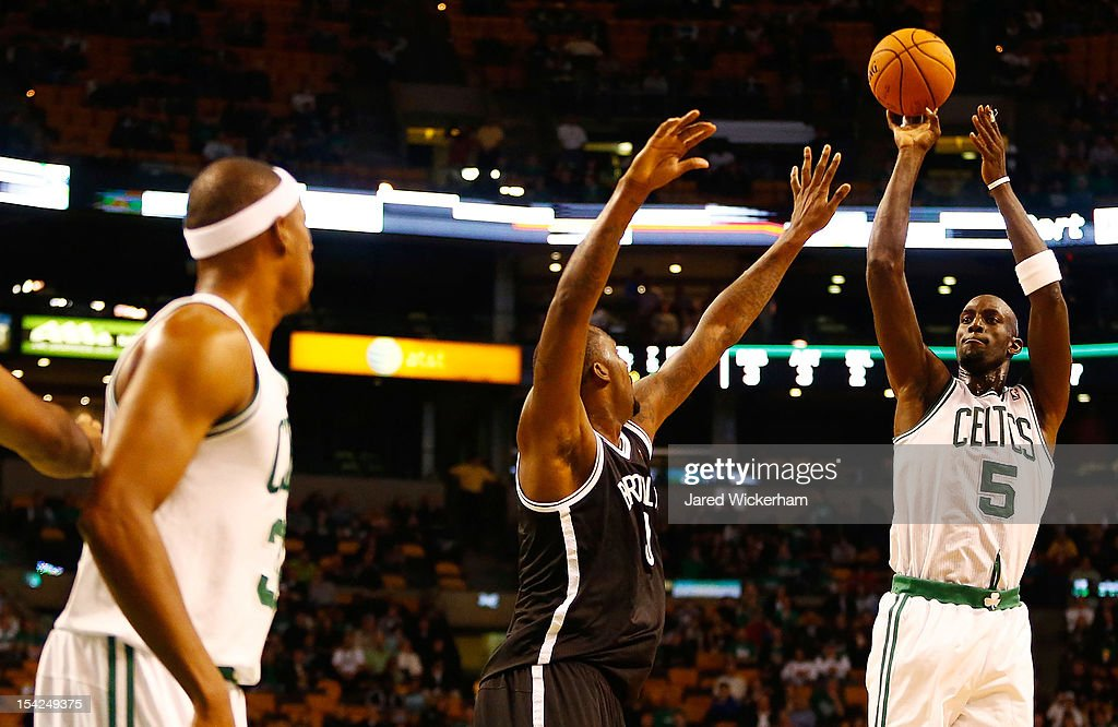 Kevin Garnett #5 of the Boston Celtics takes a shot over a member of the Brookyln Nets during the preseason game on October 16, 2012 at TD Garden in Boston, Massachusetts.
