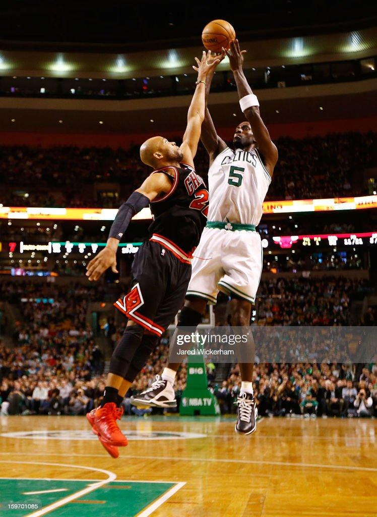Kevin Garnett #5 of the Boston Celtics takes a shot over Taj Gibson #22 of the Chicago Bulls during the game on January 18, 2013 at TD Garden in Boston, Massachusetts.