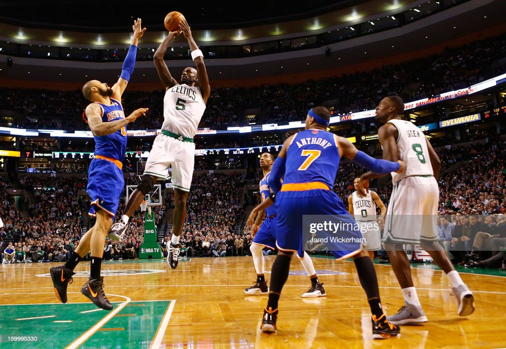 Kevin Garnett #5 of the Boston Celtics takes a shot over Tyson Chandler #6 of the New York Knicks during the game on January 24, 2013 at TD Garden in Boston, Massachusetts.