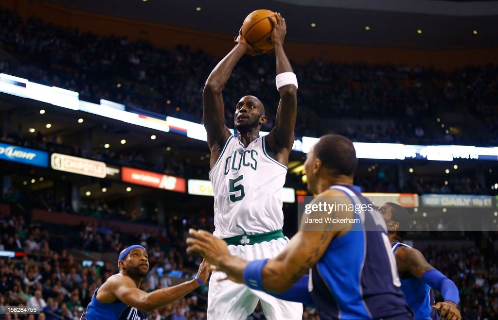 Kevin Garnett #5 of the Boston Celtics takes a shot over Vince Carter #25 of the Dallas Mavericks during the game on December 12, 2012 at TD Garden in Boston, Massachusetts.