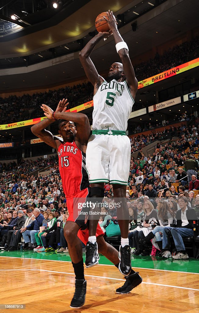 Kevin Garnett #5 of the Boston Celtics takes a shot while being guarded by Amir Johnson #15 of the Toronto Raptors on November 17, 2012 at the TD Garden in Boston, Massachusetts.