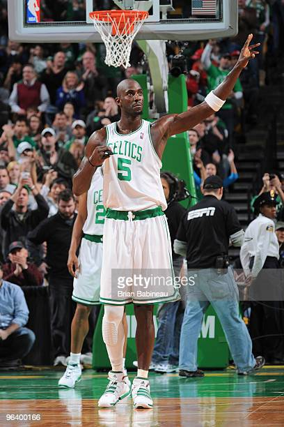 Kevin Garnett of the Boston Celtics waves to the crowd after passing Larry Bird on the all time scorers list during the game against the Miami Heat...