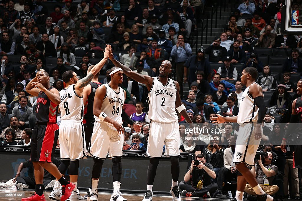 <a gi-track='captionPersonalityLinkClicked' href=/galleries/search?phrase=Kevin+Garnett&family=editorial&specificpeople=201473 ng-click='$event.stopPropagation()'>Kevin Garnett</a> #30 of the Brooklyn Nets and Deron Williams #8 of the Brooklyn Nets react against the Toronto Raptors during a game at Barclays Center in Brooklyn.